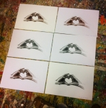 Test reproduction prints of the Hearted Hands drawing